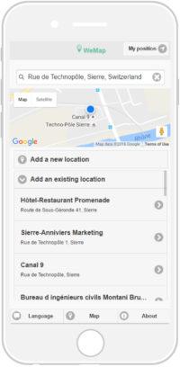 L'écran du téléphone portable montre l'interface de recherche du lieu que l'on souhaite visiter.
