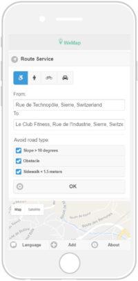 L'écran du téléphone portable montre le menu, qui sert à indiquer la route à prendre.